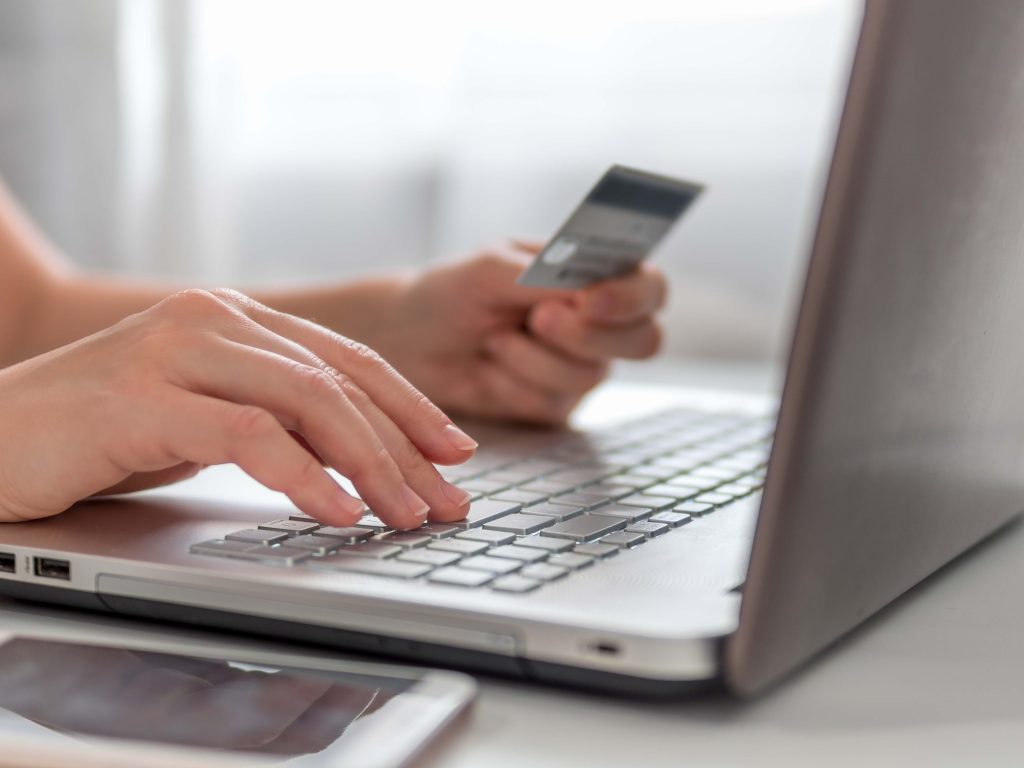 Online shopping on a retail store website. Using a credit card to shop online.
